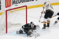 Los Angeles Kings goaltender Calvin Petersen, left, is scored on by Vegas Golden Knights right wing Mark Stone during the second period of an NHL hockey game Monday, April 12, 2021, in Los Angeles. (AP Photo/Mark J. Terrill)