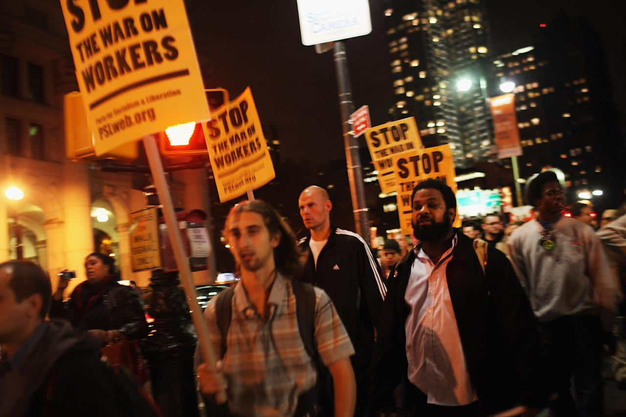 NEW YORK, NY - OCTOBER 26:  Occupy Wall Street protesters demonstrate to show support for their counterparts in Oakland, California on October 26, 2011 in New York City. Police fired tear gas into a crowd of hundreds of protesters associated with the Occupy Oakland movement last night following their eviction from a local park.  (Photo by Spencer Platt/Getty Images)