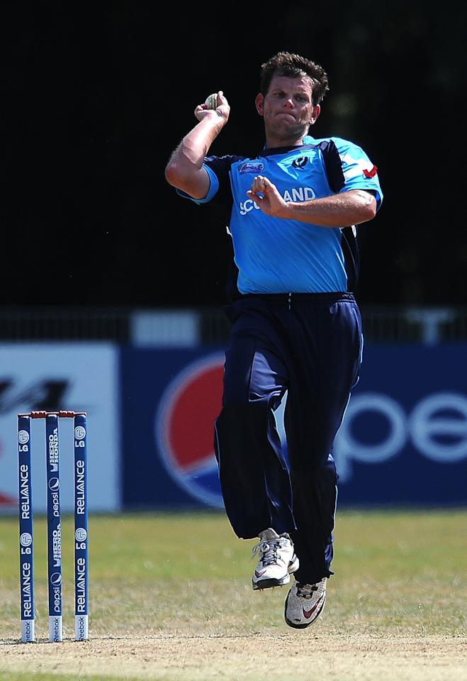 AMSTELVEEN, NETHERLANDS - JULY 10:  Gordon Drummond of Scotland in action during the ICC World Cricket League Final between Ireland and Scotland at the VRC Amstelveen Cricket Ground on July 10, 2010 in Amstelveen, Netherlands.  (Photo by Christopher Lee/Getty Images)
