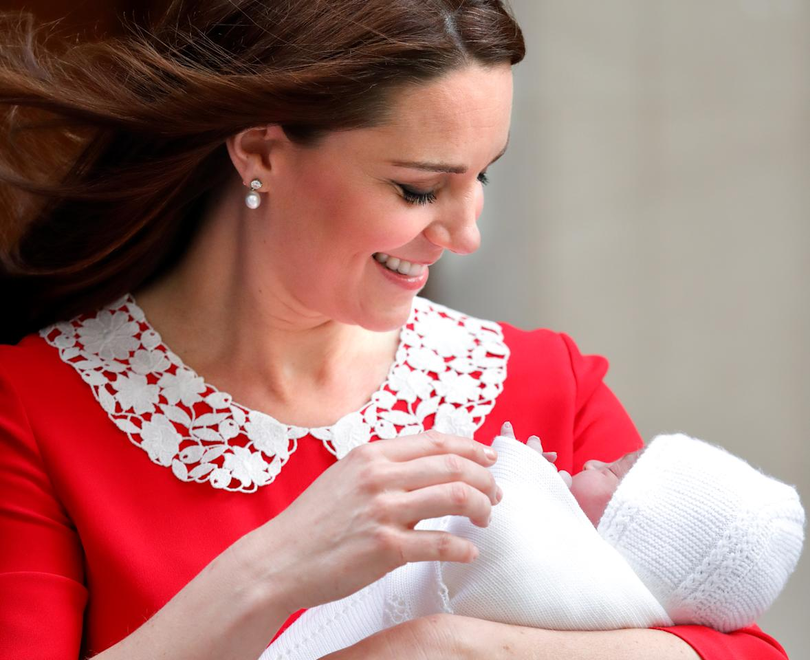 <p>Kate and William welcomed their third child Prince Louis on April 23, 2018. Kate wore a red Jenny Packham dress with a Peter Pan collar to leave the Lindo Wing (Getty) </p>