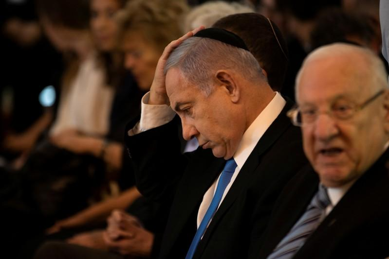 Israeli Prime Minister Benjamin Netanyahu takes part in a memorial ceremony held at the supreme court honouring former Supreme Court president Meir Shamgar who died on Saturday in Jerusalem
