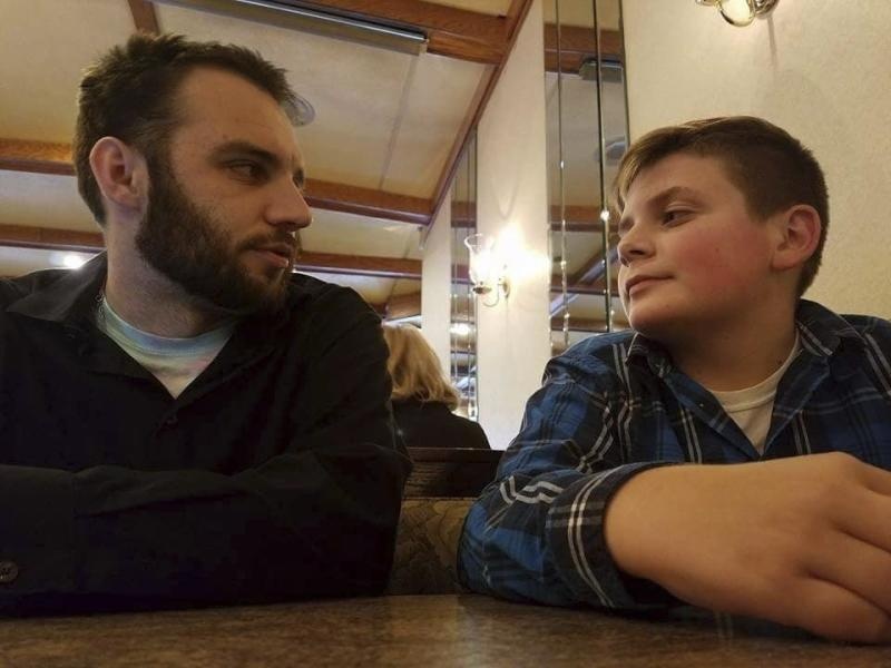 CORRECTS FIRST NAME TO TRENT FROM BRENT - In this Oct. 4, 2017, photo provided by Janel Firestone, Brandon Wentz, left, and his younger brother Trent Firestone sit in a restaurant in Minersville, Pa. Wentz's family is speaking out for the first time about his sudden death one year ago. Wentz was 22 when he became mayor of Mount Carbon, population 87. He died suddenly last November at age 24, just hours after resigning from office due to a family move. Wentz's family says he died of an overdose of heroin and fentanyl. His passing came near the end of a year that saw a record number of drug overdose deaths. (Janel Firestone via AP)