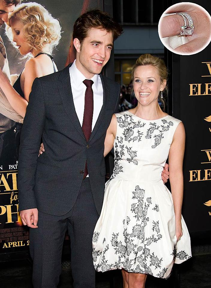 "Newlywed Reese Witherspoon debuted her diamond-and-platinum wedding band in New York on Sunday night at the premiere of ""Water For Elephants,"" the new big-screen romance she's starring in with Robert Pattinson. Reese married agent Jim Toth at a star-studded wedding on her estate in Ojai, California, last month. Gilbert Carrasquillo/<a href=""http://www.filmmagic.com/"" target=""new"">FilmMagic.com</a> - April 17, 2011"