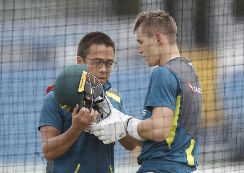 LEEDS, ENGLAND - AUGUST 20: Marnus Labuschagne of Australia is assessed by Australian Team Doctor Richard Saw after being struck in the helmet by a delivery from Mitchell Starc of Australia during the Australia Nets session at Headingley on August 20, 2019 in Leeds, England. (Photo by Ryan Pierse/Getty Images)