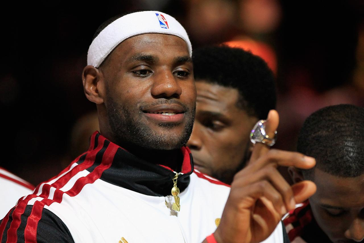 MIAMI, FL - OCTOBER 30:  LeBron James #6 of the Miami Heat looks at his 2012 NBA Championship ring following a ceremony prior to the game against the Boston Celtics at American Airlines Arena on October 30, 2012 in Miami, Florida. NOTE TO USER: User expressly acknowledges and agrees that, by downloading and/or using this Photograph, user is consenting to the terms and conditions of the Getty Images License Agreement. (Photo by Chris Trotman/Getty Images)