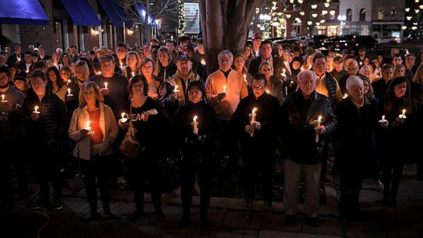 PHOTO: People gather for a candlelight vigil to honor Clayton Beathard and Paul Trapeni III on the steps of the historic Williamson County Courthouse in Franklin, Tenn., on Dec. 26, 2019. (The Tennessean via USA Today Network)