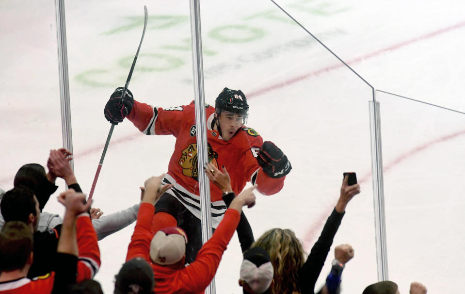 Chicago Blackhawks left wing Alexandre Fortin (84) celebrates after scoring a goal against the Tampa Bay Lightning during the first period of an NHL hockey game on Sunday Oct. 21, 2018, in Chicago. (AP Photo/Matt Marton)