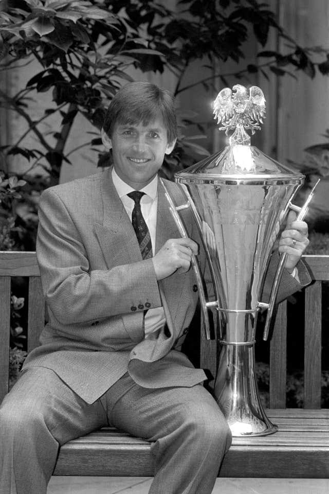 Kenny Dalglish with his Barclays Bank Trophy after being named Football Manager of the Year 1990