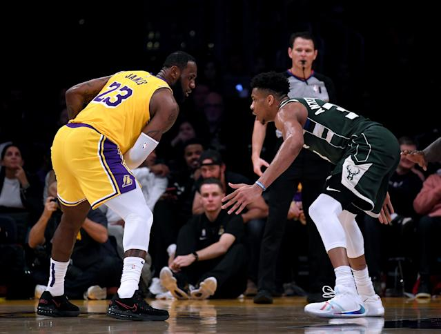 """<a class=""""link rapid-noclick-resp"""" href=""""/nba/players/3704/"""" data-ylk=""""slk:LeBron James"""">LeBron James</a> and <a class=""""link rapid-noclick-resp"""" href=""""/nba/players/5185/"""" data-ylk=""""slk:Giannis Antetokounmpo"""">Giannis Antetokounmpo</a> will almost certainly headline the NBA's top-seeded playoff teams. (Harry How/Getty Images)"""