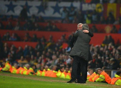 Manchester United manager Alex Ferguson (L) and Real Madrid boss Jose Mourinho embrace towards the end of the UEFA Champions League match on March 5, 2013. Mourinho expressed sympathy with Ferguson after the Spanish side's controversial victory