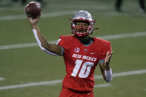 New Mexico quarterback Trae Hall (10) throws against Nevada during the first half of an NCAA college football game Saturday, Nov. 14, 2020, in Las Vegas. (AP Photo/John Locher)