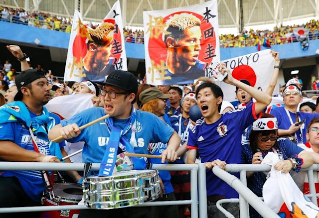 Japan fans celebrate the 2-1 win over Colombia in Saransk (AFP Photo/Jack GUEZ )