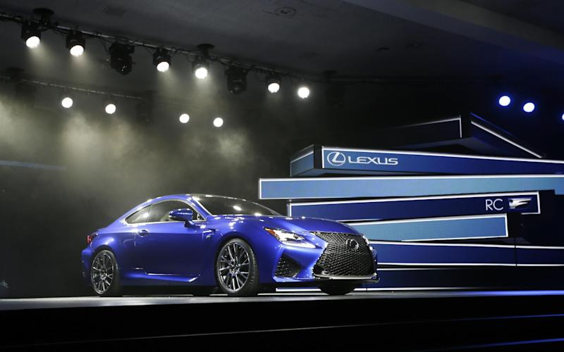 FILE - In this Jan. 14, 2014 file photo,  the Lexus RC F Coupe is unveiled at the at the North American International Auto Show in Detroit. Technology glitches including Bluetooth phone pairing and misunderstood voice commands dented car and truck reliability scores in a major survey of automobile owners. Lexus and Porsche tied for the top spot, leading all brands for dependability in the survey released Wednesday, Feb. 22, 2017,  by the consulting firm J.D. Power.(AP Photo/Carlos Osorio, File)