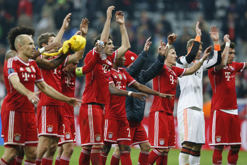 Bayern players celebrate advancing to the quarterfinal after the Champions League round of 16 second leg soccer match between FC Bayern Munich and FC Arsenal in Munich, Germany, Wednesday, March 12, 2014. (AP Photo/Matthias Schrader)