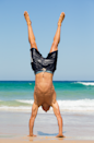 <p>One of the lifeguards does a handstand, all in the name of charity.</p>