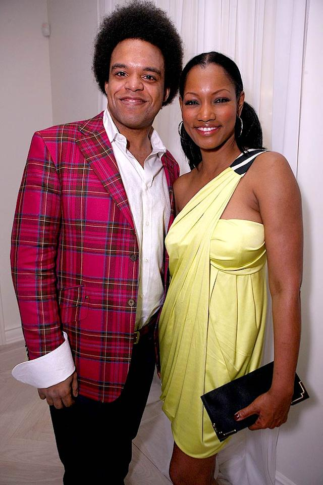 "It's hard to believe that Garcelle Beauvas-Nilon is 41! The model/actress and new mom of twins is still glowing. We're not quite sure what's going on with her ill-dressed guest though. Chris Weeks/<a href=""http://www.wireimage.com"" target=""new"">WireImage.com</a> - March 20, 2008"