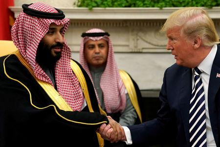FILE PHOTO: U.S. President Trump shakes hands with Saudi Arabia's Crown Prince Mohammed bin Salman in the Oval Office at the White House in Washington