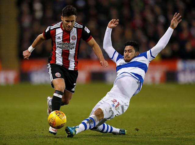 "Soccer Football - Championship - Sheffield United vs Queens Park Rangers - Bramall Lane, Sheffield, Britain - February 20, 2018 Sheffield United's George Baldock in action with Queens Park Rangers' Massimo Luongo Action Images/Ed Sykes EDITORIAL USE ONLY. No use with unauthorized audio, video, data, fixture lists, club/league logos or ""live"" services. Online in-match use limited to 75 images, no video emulation. No use in betting, games or single club/league/player publications. Please contact your account representative for further details."
