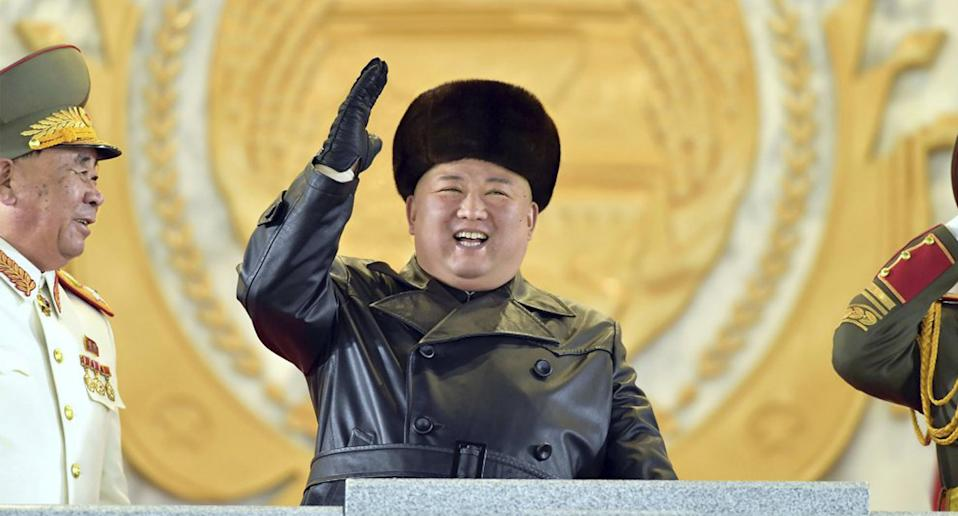 North Korean leader Kim Jong Un waves as Kim attended a military parade, marking the ruling party congress, at Kim Il Sung Square in Pyongyang, North Korea