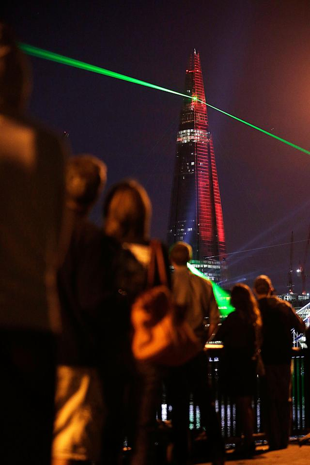 Laser lights shine from The Shard over Tower Bridge on July 5, 2012 in London, England. The European Union's highest building designed by Italian architect Renzo Piano, stands at 310 meters tall situated on London's Southbank is formally inaugurated this evening at 10pm with a laser show that will also be streamed live on the internet. (  (Photo by Matthew Lloyd/Getty Images)