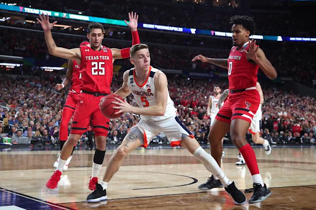Kyle Guy #5 of the Virginia Cavaliers is defended by Davide Moretti #25 and Kyler Edwards #0 of the Texas Tech Red Raiders during the 2019 NCAA men's Final Four National Championship game at U.S. Bank Stadium on April 08, 2019 in Minneapolis, Minnesota. (Photo by Tom Pennington/Getty Images)
