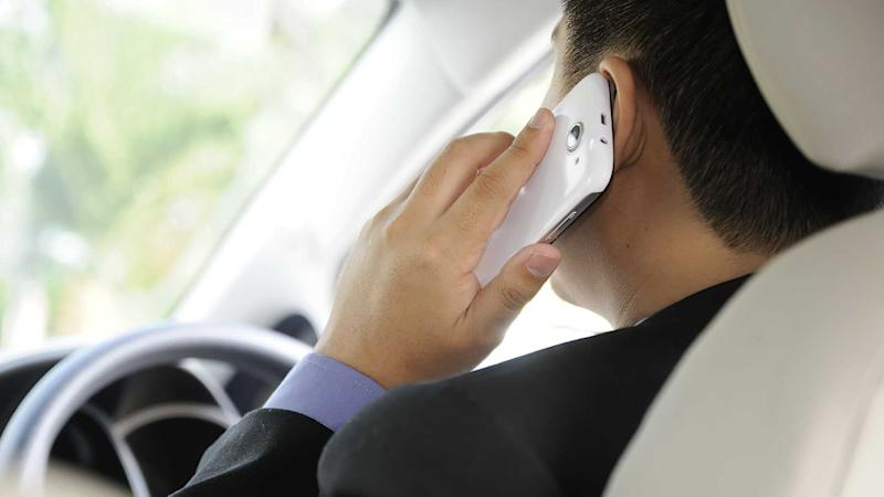 Man talking on smartphone while driving