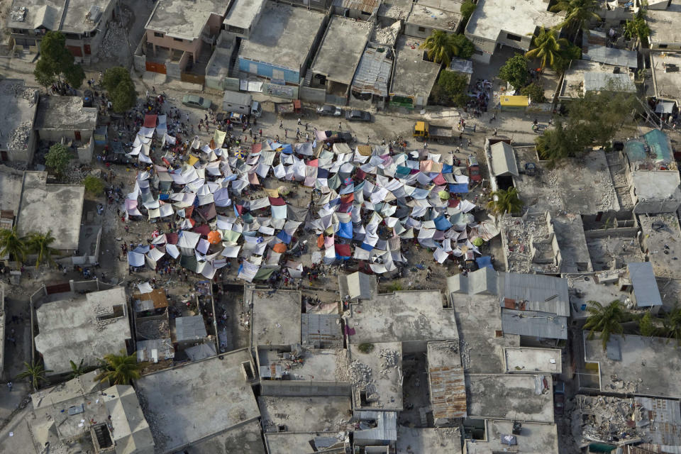 <p>Makeshift tents are seen after an earthquake on Jan. 13, 2010 in Port-au-Prince, Haiti. (Photo: Logan Abassi/MINUSTAH via Getty Images) </p>