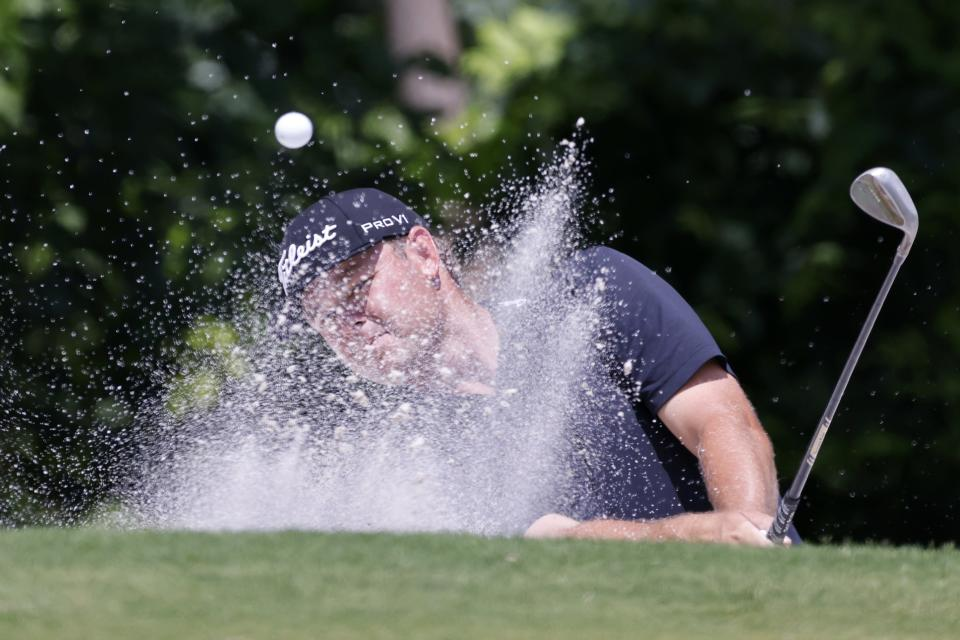 Patton Kizzire hits out of a bunker onto the fifth green during the third round of the Charles Schwab Challenge golf tournament at Colonial Country Club in Fort Worth, Texas, Saturday May 29, 2021. (AP Photo/Ron Jenkins)