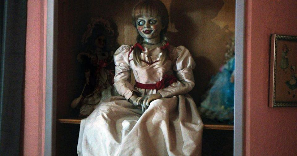 """<p>Most horror enthusiasts know of the <a href=""""http://www.popsugar.com/entertainment/Annabelle-Doll-True-Story-43864969"""" class=""""link rapid-noclick-resp"""" rel=""""nofollow noopener"""" target=""""_blank"""" data-ylk=""""slk:super creepy Annabelle doll"""">super creepy Annabelle doll</a> in the Conjuring universe, which was so frighteningly lucrative that it landed three spinoff films: <strong>Annabelle</strong>, <strong>Annabelle: Creation</strong>, and <strong>Annabelle Comes Home</strong>. The real Annabelle doll was an innocent-looking rag doll that for years sat in the Warrens' now-closed <a href=""""https://www.atlasobscura.com/places/the-warrens-occult-museum-monroe-connecticut"""" class=""""link rapid-noclick-resp"""" rel=""""nofollow noopener"""" target=""""_blank"""" data-ylk=""""slk:Occult Museum"""">Occult Museum</a>. The story begins in 1970 when a mother <a href=""""https://www.hollywoodreporter.com/heat-vision/annabelle-comes-home-real-stories-behind-artifacts-1216397"""" class=""""link rapid-noclick-resp"""" rel=""""nofollow noopener"""" target=""""_blank"""" data-ylk=""""slk:bought the doll at a hobby shop for her daughter, a nurse"""">bought the doll at a hobby shop for her daughter, a nurse</a>. Things got weird fast when the doll <a href=""""https://www.usatoday.com/story/life/movies/2017/08/07/annabelle-creation-true-story-evil-doll-star/543202001/"""" class=""""link rapid-noclick-resp"""" rel=""""nofollow noopener"""" target=""""_blank"""" data-ylk=""""slk:levitated and moved around"""">levitated and moved around</a>. People were convinced that it tried to strangle them by means of dreams and necklaces. </p> <p>The Warrens came in and determined that the toy was possessed by an inhuman demonic spirit, locking it up in their museum with <a href=""""https://www.usatoday.com/story/life/movies/2017/08/07/annabelle-creation-true-story-evil-doll-star/543202001/"""" class=""""link rapid-noclick-resp"""" rel=""""nofollow noopener"""" target=""""_blank"""" data-ylk=""""slk:ritualistic prayers"""">ritualistic prayers</a> soon after. We'll be sticking with our mass-produced Barbies, thanks. <"""