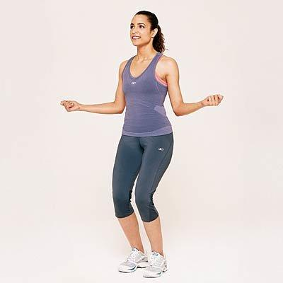 """<p><b>Time:</b> 1 minute and 30 seconds</p> <p><b>Works:</b> <i>thighs, calves, shoulders, back—plus cardio</i></p> <p>Stand with your legs slightly bent, your arms bent, and your hands out to your sides. Begin jumping, leaving only a few inches between your feet and the floor as you hop. At the same time, rotate your shoulders and arms as if you are jumping rope without the rope. Continue for 1 minute and 30 seconds, then move directly to Squats.</p> <p><b>RELATED: </b><a href=""""https://www.health.com/fitness/janine-delaney-jump-rope-workout-video""""><b>This Heart-Pumping Jump Rope Workout Is the Cardio You've Been Missing</b></a></p>"""