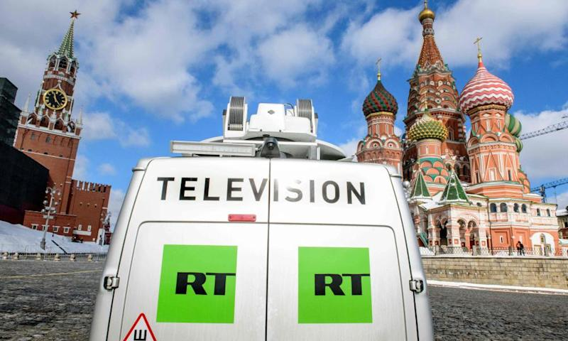 A Russia Today TV broadcast van in front of St Basil's Cathedral and the Kremlin next to Red Square in Moscow