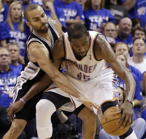 San Antonio Spurs guard Tony Parker, left, of France tries to steal the ball from Oklahoma City Thunder forward Kevin Durant (35) during the second half of Game 4 in the NBA basketball playoffs Western Conference finals, Saturday, June 2, 2012, in Oklahoma City. The Thunder won 109-103. (AP Photo/Sue Ogrocki)