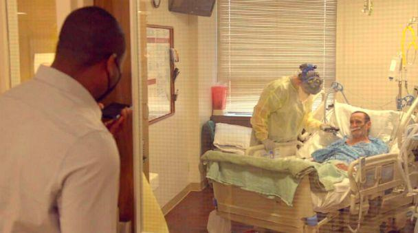 PHOTO: Marcus Moore speaks with 75-year-old COVID-19 patient, Curtis Cannon at Willis-Knighton Hospital in Shreveport, Louisiana. (ABC News)