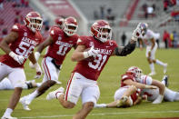 Arkansas defensive back Grant Morgan (31) celebrates as he returns an interception for a touchdown against Mississippi during the second half of an NCAA college football game Saturday, Oct. 17, 2020, in Fayetteville, Ark. (AP Photo/Michael Woods)