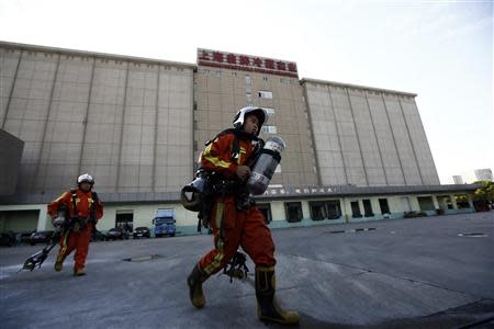 Rescuers walk inside a refrigeration unit of Shanghai Weng's Cold Storage Industrial Co. Ltd., in the Baoshan district of Shanghai August 31, 2013. REUTERS/Aly Song