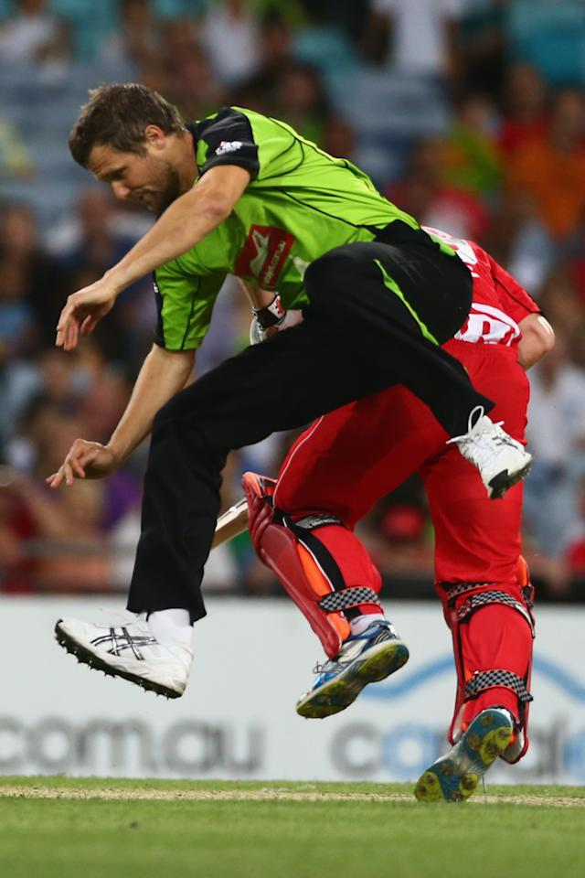 SYDNEY, AUSTRALIA - DECEMBER 14: Dirk Nannes of the Thunder and Aaron Finch of the Renegades collide during the Big Bash League match between the Sydney Thunder and the Melbourne Renegades at ANZ Stadium on December 14, 2012 in Sydney, Australia.  (Photo by Mark Kolbe/Getty Images)