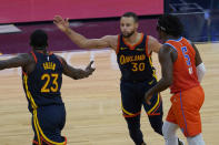 Golden State Warriors forward Draymond Green (23) and guard Stephen Curry (30) celebrate next to Oklahoma City Thunder forward Luguentz Dort (5) during the second half of an NBA basketball game in San Francisco, Thursday, May 6, 2021. (AP Photo/Jeff Chiu)