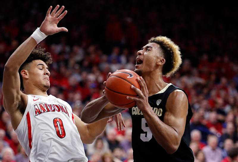 TUCSON, AZ - JANUARY 18: Arizona Wildcats guard Josh Green (0) defends Colorado Buffaloes guard D'Shawn Schwartz (5) during the first half of the college basketball game at McKale Center on January 18, 2020 in Tucson, Arizona. (Photo by Chris Coduto/Icon Sportswire via Getty Images)