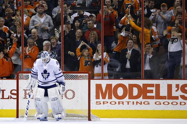 Toronto Maple Leafs' Jonathan Bernier sweeps the ice in front of the net after giving up a goal to Philadelphia Flyers' Wayne Simmonds during the third period of an NHL hockey game, Friday, March 28, 2014, in Philadelphia. Philadelphia won 4-2. (AP Photo/Matt Slocum)