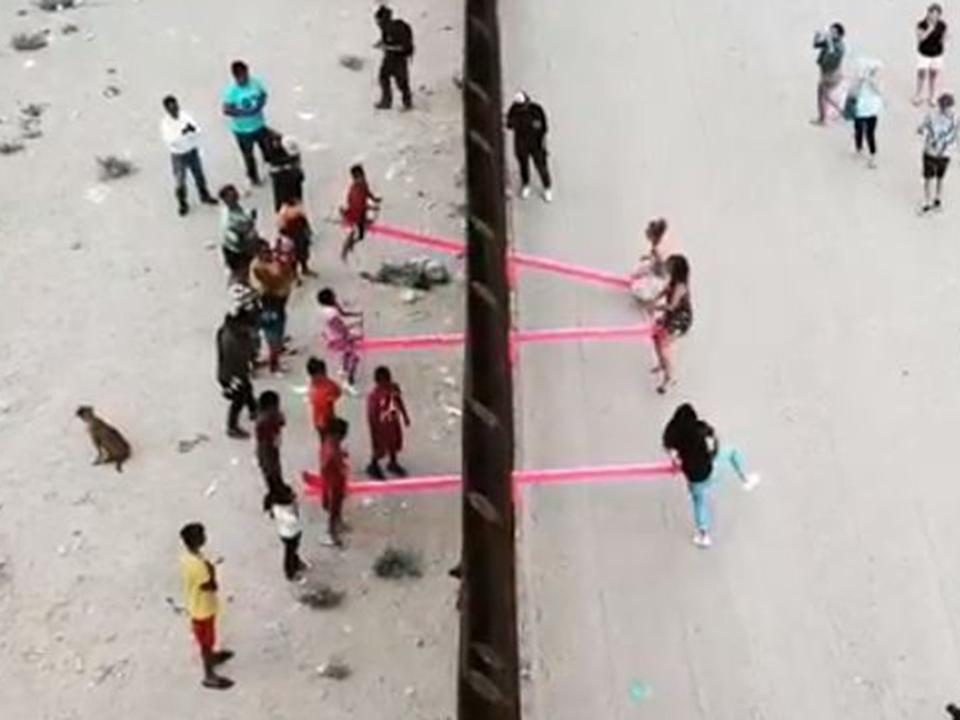 Pink seesaws created a 'literal fulcrum for US-Mexico relations', according to inventors (Ronald Rael)