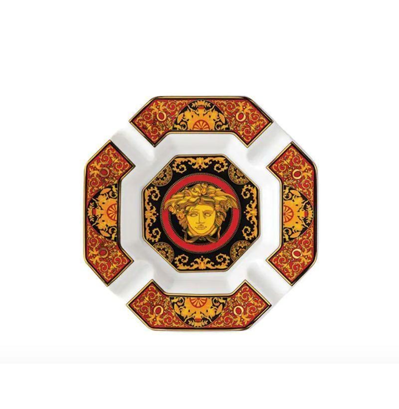 """<p><strong>Versace</strong></p><p>luisaviaroma.com</p><p><strong>$268.00</strong></p><p><a href=""""https://go.redirectingat.com?id=74968X1596630&url=https%3A%2F%2Fwww.luisaviaroma.com%2Fen-us%2Fp%2Fversace%2Fhome%2Fsmoking-accessories%2F71I-0VT039%3FColorId%3DUkVEL1dISVRF0%26SubLine%3Dhome-accessories%26CategoryId%3D206%26lvrid%3D_p_dN5F_ge_c206&sref=https%3A%2F%2Fwww.esquire.com%2Flifestyle%2Fcars%2Fg32799357%2Fbest-ash-trays-for-men%2F"""" rel=""""nofollow noopener"""" target=""""_blank"""" data-ylk=""""slk:Buy"""" class=""""link rapid-noclick-resp"""">Buy</a></p><p>Medusa head on me like I'm in the Illuminati. </p>"""