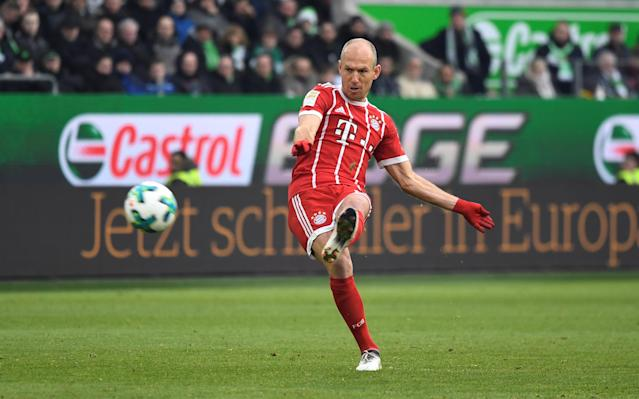 Soccer Football - Bundesliga - VfL Wolfsburg vs Bayern Munich - Volkswagen Arena, Wolfsburg, Germany - February 17, 2018 Bayern Munich's Arjen Robben takes a free kick REUTERS/Fabian Bimmer DFL RULES TO LIMIT THE ONLINE USAGE DURING MATCH TIME TO 15 PICTURES PER GAME. IMAGE SEQUENCES TO SIMULATE VIDEO IS NOT ALLOWED AT ANY TIME. FOR FURTHER QUERIES PLEASE CONTACT DFL DIRECTLY AT + 49 69 650050