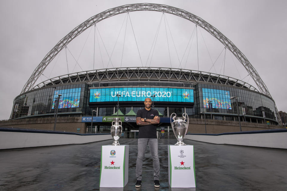Thierry Henry, Global Heineken® Ambassador with the EURO 2020 Trophy and UEFA Champions League Trophy at Wembley Stadium, London to announce Heineken's sponsorship of the EURO 2020 Championships and renewal of the UEFA Champions League Sponsorship.
