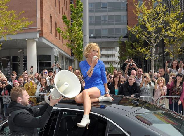 Celebrity photos: Geri Halliwell returned to The X Factor as a guest judge as the auditions kicked off this week. The star made a grand entrance, clambering out of her car and sitting on the roof, shouting to fans through a megaphone.