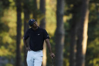 Tiger Woods waits to putt on the eighth green during the second round of the Masters golf tournament Friday, Nov. 13, 2020, in Augusta, Ga. (AP Photo/Charlie Riedel)