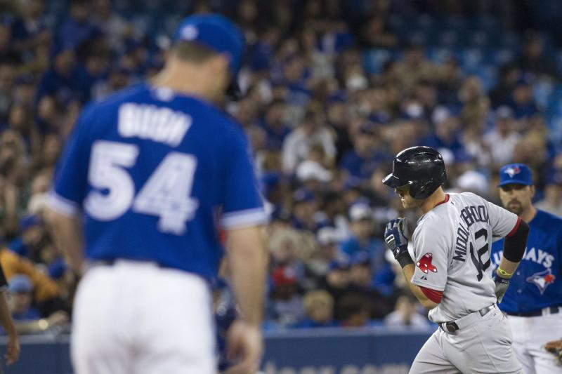 Boston Red Sox Will Middlebrooks, right, rounds the bases after hitting a home run off Toronto Blue Jays pitcher Dave Bush, left, during seventh inning of MLB baseball action inToronto on Sunday April 7, 2013. (AP PHOTO/THE CANADIAN PRESS,Chris Young)