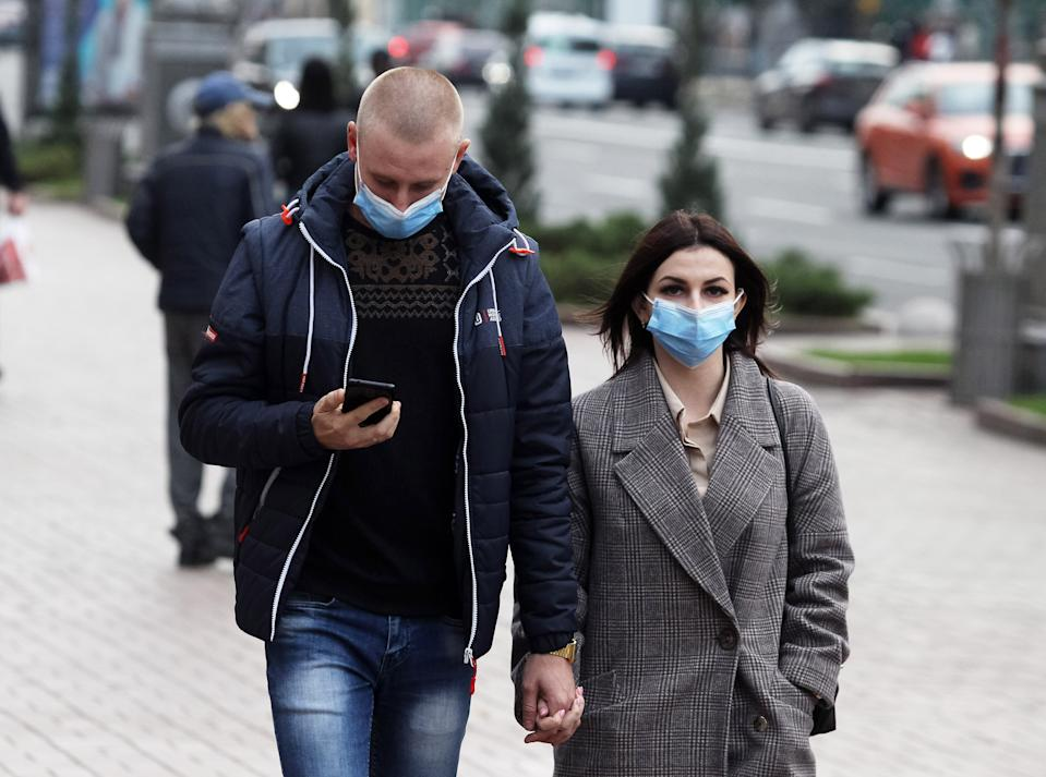 People pictured in masks.