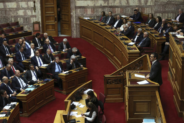 Greek Prime Minister Alexis Tsipras, right, speaks during a parliamentary session in Athens, on Tuesday, Jan. 15, 2019. Greece's prime minister is defending his deal to normalize relations with neighboring Macedonia ahead of a confidence vote in parliament after his governing coalition collapsed over the agreement. (AP Photo/Petros Giannakouris)