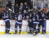 Winnipeg Jets coach Paul Maurice talks to players during a timeout during the third period of the team's NHL hockey game against the Vegas Golden Knights on Tuesday, Jan. 15, 2019, in Winnipeg, Manitoba. (Trevor Hagan/The Canadian Press via AP)