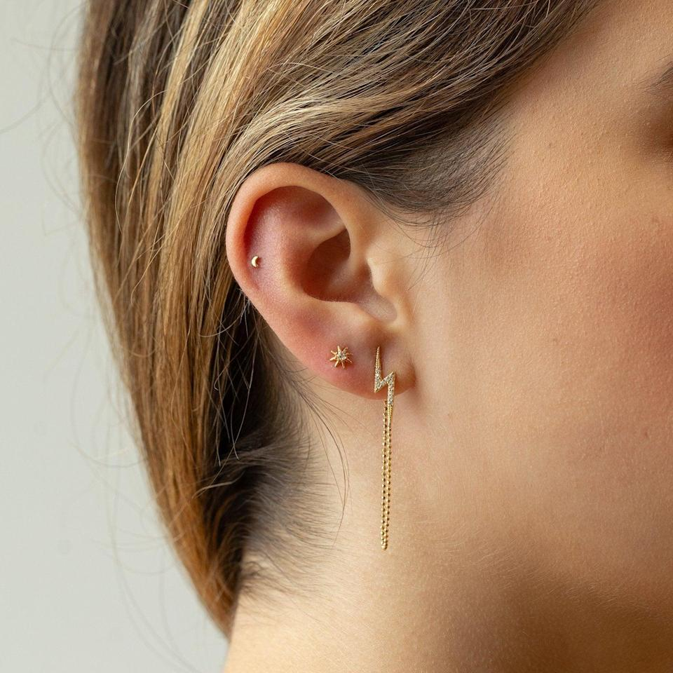 """<h2>Studs Tiny Moon Stud<br></h2><br>""""Cancers are ruled by the moon, so invoke that lunar energy with a tasteful piece of silver jewelry,"""" Potter says.<br><br><strong>Studs</strong> Tiny Moon Stud, $, available at <a href=""""https://go.skimresources.com/?id=30283X879131&url=https%3A%2F%2Fstuds.com%2Fproducts%2Fmini-moon-stud%3Fvariant%3D30234651820141"""" rel=""""nofollow noopener"""" target=""""_blank"""" data-ylk=""""slk:Studs"""" class=""""link rapid-noclick-resp"""">Studs</a>"""